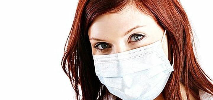 Feinstaub – Frau mit Mundschutz
