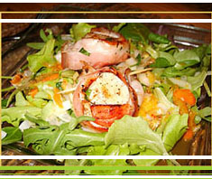 gebratene Jakobsmuscheln auf Rucola-Salat